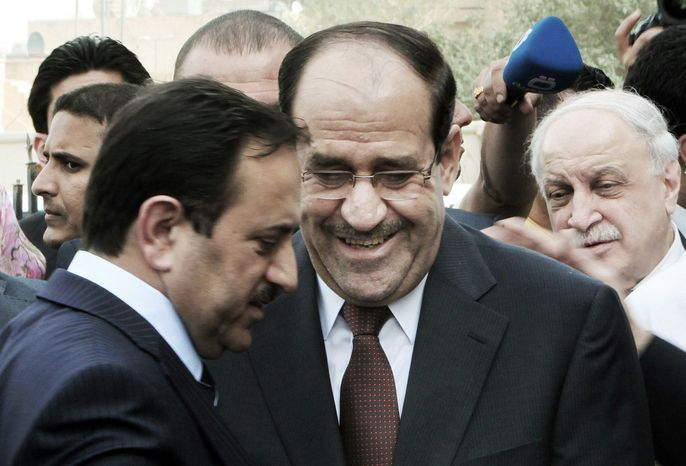 Iraqi Prime Minister Nouri al-Maliki (center) attends a meeting of Arab economic, finance and trade ministers as part of the Arab League summit in Baghdad on Tuesday. Economic ministers from across the Arab world are looking at ways to develop tourism and ensure access to increasingly strapped water supplies in the region to boost economic stability in their countries. (Associated Press)