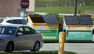 Medical records were found Saturday, March 24, 2012, inside this paper recycling container in the parking lot at the Brookridge Elementary School in Overland Park, Kan., prompting a police investigation and outrage from people on both sides of the abortion debate. (AP Photo/The Kansas City Star, David Eulitt)