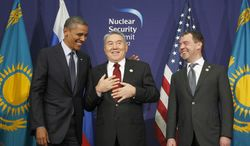 U.S. President Barack Obama, left, laughs with Kazakhstan President Nursultan Nazarbayev, center, and Russian President Dmitry Medvedev during their joint statement at the Nuclear Security Summit at the Coex Center, in Seoul, South Korea, Tuesday, March 27, 2012. (AP Photo/Pablo Martinez Monsivais)