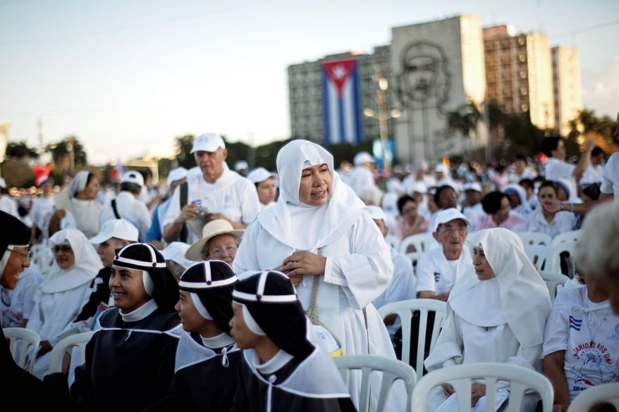 Nuns wait with others in the crowd gathered for the pope's arrival at Revolution Square. The pontiff urged greater freedom of religion for Cubans.