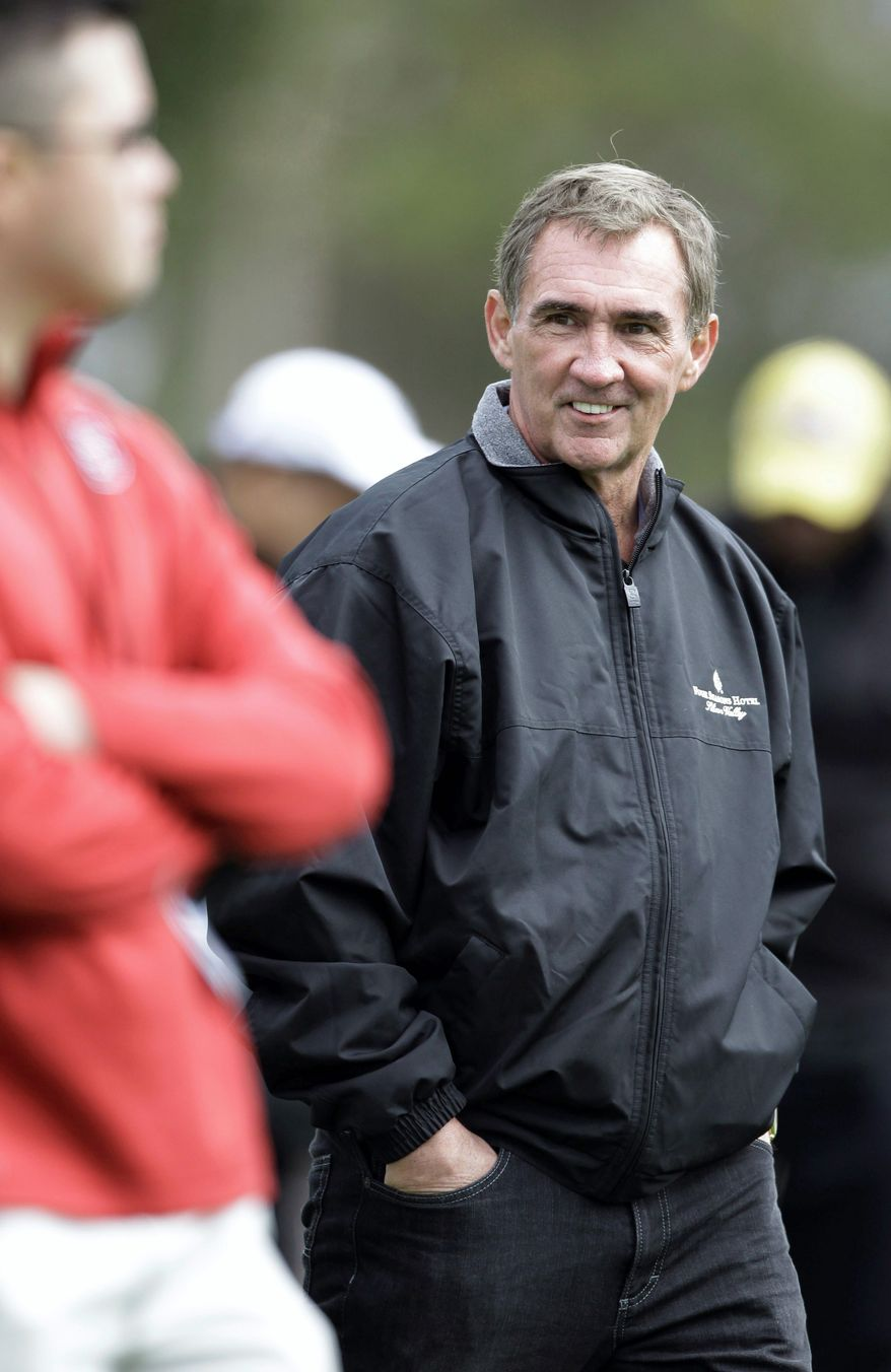 Mike Shanahan will coach a touted rookie quarterback - most likely Heisman Trophy winner Robert Griffin III - as a result of the Redskins trading up with St. Louis for the second overall pick. (Associated Press)