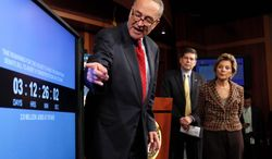 """Sen. Charles E. Schumer points to a countdown clock on the transportation bill on Capitol Hill, pushing the House to pass the Senate bill. Sens. Mark Begich and Barbara Boxer are behind him. """"Speaker [John A.} Boehner has once again been painted in a corner by the tea-party wing of his caucus,"""" Mr. Schumer said Wednesday. (Associated Press)"""