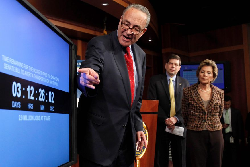 "Sen. Charles E. Schumer points to a countdown clock on the transportation bill on Capitol Hill, pushing the House to pass the Senate bill. Sens. Mark Begich and Barbara Boxer are behind him. ""Speaker [John A.} Boehner has once again been painted in a corner by the tea-party wing of his caucus,"" Mr. Schumer said Wednesday. (Associated Press)"