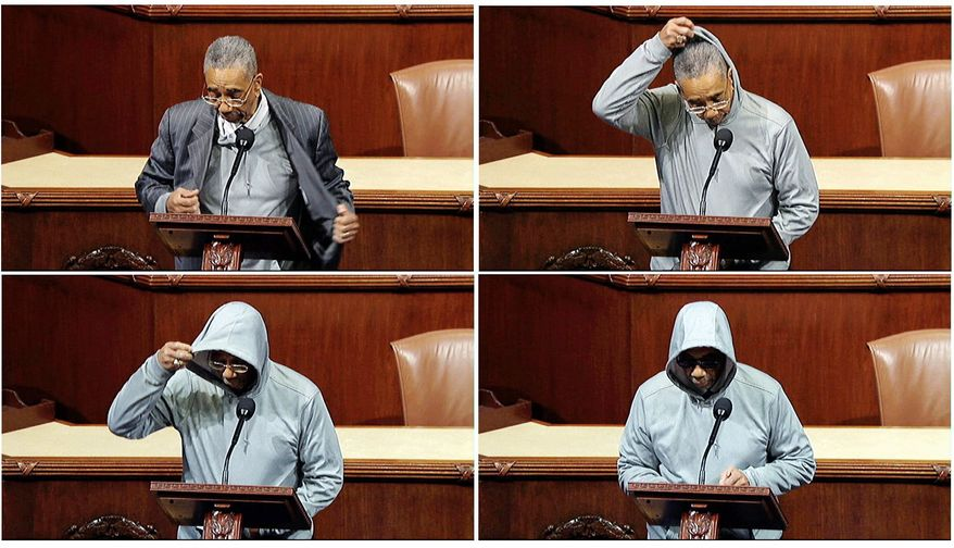 Rep. Bobby L. Rush, Illinois Democrat, dons a hoodie and sunglasses while speaking on the House floor Wednesday. Mr. Rush, who was escorted away for a violation of House rules, said racial profiling led to the shooting death of Trayvon Martin, an unarmed black teenager. (Associated Press)