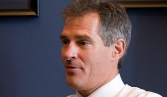 Sen. Scott P. Brown, Massachusetts Republican, has transferred from his state's National Guard to a unit in Maryland, which allows him to serve in the Pentagon. (Associated Press)