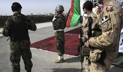 Canadian soldiers (right), part of the NATO-led International Security Assistance Force (ISAF), attend a graduation ceremony for Afghan soldiers at a military training center in Kabul, Afghanistan, on Wednesday, March 14, 2012. (AP Photo/Musadeq Sadeq)