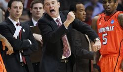 FILE - In this March 22, 2012 file photo, Louisville coach Rick Pitino reacts during the first half of an NCAA tournament West Regional semifinal game against Michigan State, in Phoenix. Kentucky and Louisville's annual game had to be bartered by the governor to even begin. It's usually about bragging rights, but not this year. (AP Photo/Matt York, File)