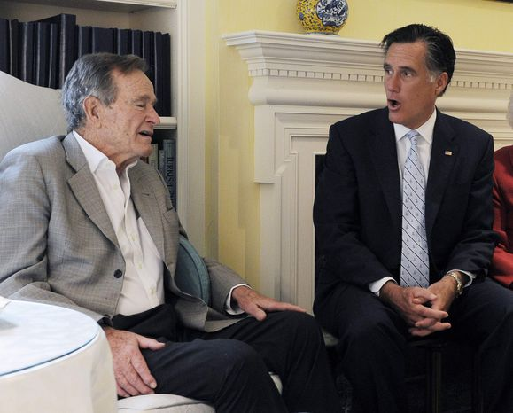 ** FILE ** In this Dec. 1, 2011, file photo, Republican presidential candidate, former Massachusetts Gov. Mitt Romney meets with former President George H.W. Bush in Houston. (AP Photo/Pat Sullivan, File)