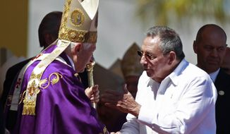 Pope Benedict XVI (left) speaks with Cuban President Raul Castro at the end of an open-air Mass in Revolution Square in Havana on Wednesday, March 28, 2012. (AP Photo/Ramon Espinosa)