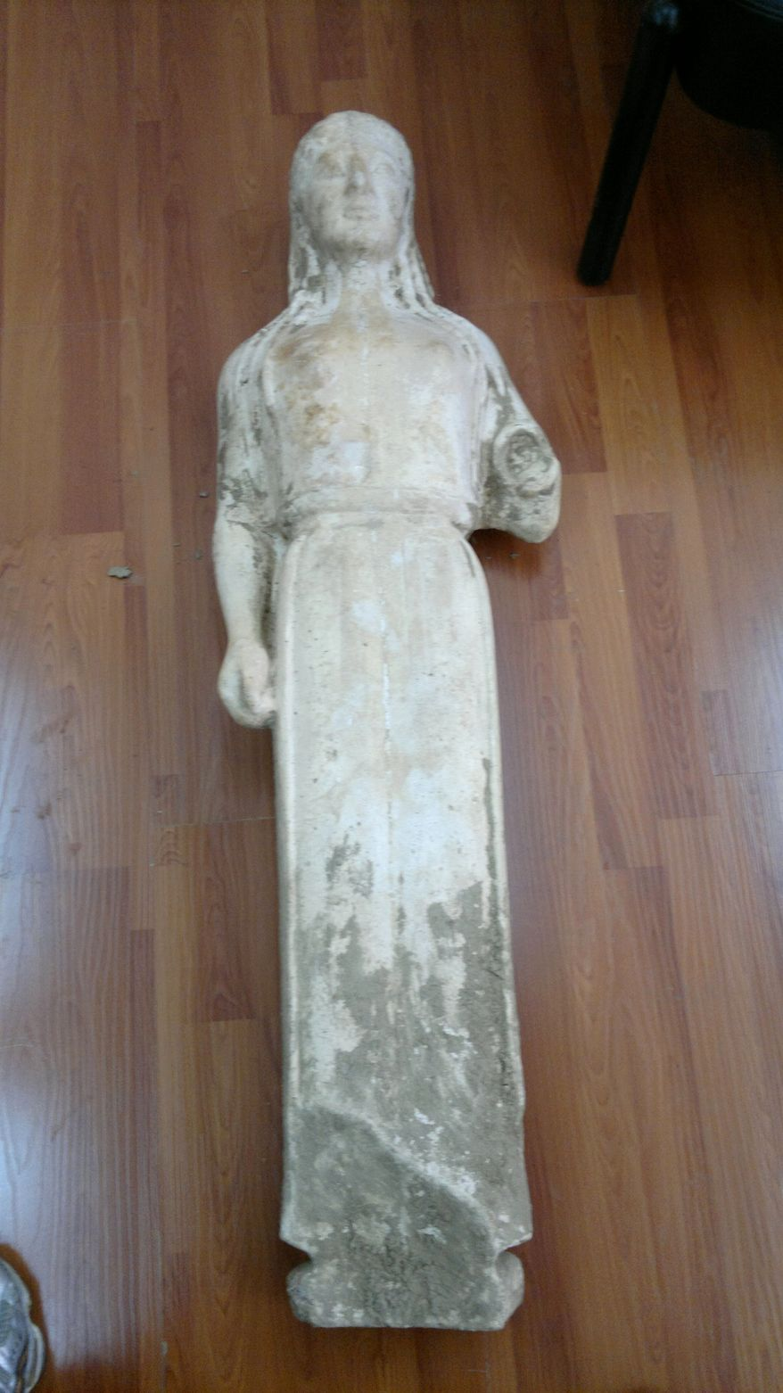 Greek police have recovered a 2,500-year-old statue of a young woman that was illegally excavated and hidden in a goat pen near Athens. (AP Photo/Greek police)