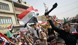 Demonstrators in Fallujah, Iraq, on Tuesday, March 27, 2012, chant slogans in support of the Arab Summit scheduled to start Thursday in Baghdad, the Iraqi capital. (AP Photo)