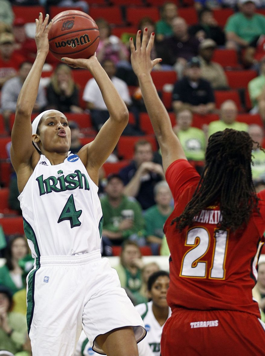 Notre Dame's Skylar Diggins shoots over Maryland's Tianna Hawkins during the second half of an NCAA women's tournament regional final game in Raleigh, N.C., on Tuesday, March 27, 2012. Notre Dame won 80-49 to advance to the Final Four. (AP Photo/Gerry Broome)