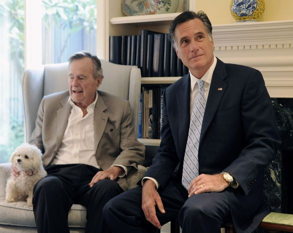 ** FILE ** Republican presidential candidate Mitt Romney meets with former President George H.W. Bush in Houston on Thursday, Dec. 1, 2011. (AP Photo/Pat Sullivan)
