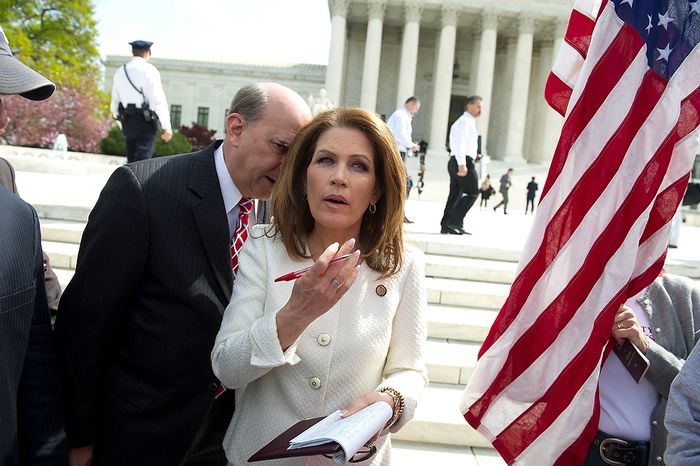 Former Presidential candidate Rep. Michele Bachmann (R-Minn) chats with Rep. Louie Gohmert (R-Tex) as they wait to speak to a crowd during a Tea Party Patriots rally in front of the Supreme Court of the United States in Washington, D.C., Wednesday, March 28, 2012, as the nation's high court takes up arguments regarding President Obama's health care overhaul. (Rod Lamkey Jr/The Washington Times)