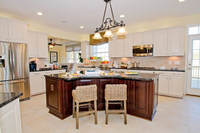 The Avery model features a center-island kitchen with granite count