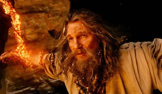 """Liam Neeson as Zeus is in a hard place between two rocks in """"Wrath of the Titans,"""" a noisy sequel to 2010's """"Clash of the Titans."""" (Warner Bros. and Legendary Pictures via Associated Press)"""