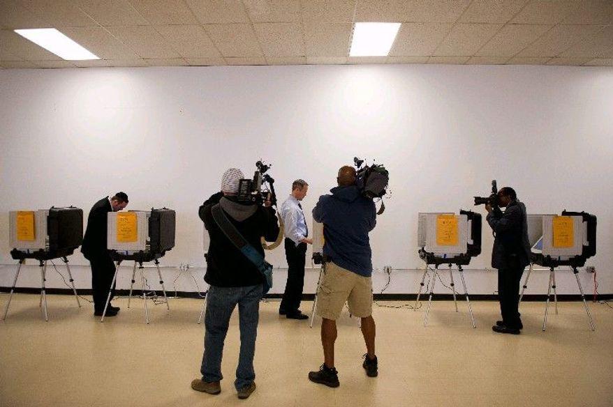 Members of the media film Maryland Gov. Martin O'Malley as he casts his ballot during early voting in the primary at his precinct at the Public Safety Training Facility in Baltimore on Thursday. Early voting for the Maryland primary began on Saturday and ended on Thursday. (Andrew Harnik/The Washington Times)