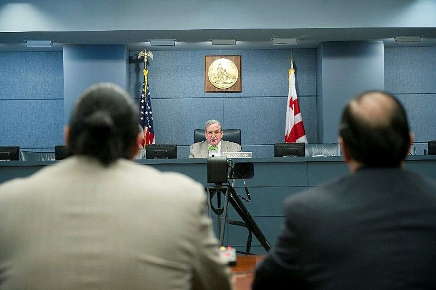 D.C. Council member Jim Graham, Ward 1 Democrat, listens to testimony Thursday on the mayor's proposal to extend night-life hours. Mr. Graham opposes the one-hour extension. (Barbara L. Salisbury/The Washington Times)