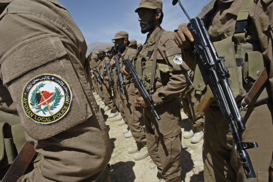 Afghan Local Police officers are chosen, based on their loyalty, by village elders who are opposed to the Taliban. The members are geared for defense and trained by U.S. special-operations forces. Each local force is dedicated to one village. (Associated Press)