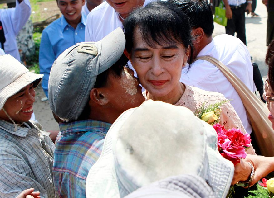 Once persecuted by her government, Myanmar pro-democracy icon Aung San Suu Kyi is seen as having a good chance to win a seat in parliament. (Associated Press)