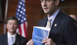 **FILE** House Budget Chairman Rep. Paul Ryan (right), Wisconsin Republican, with Republican Conference Chairman Rep. Jeb Hensarling of Texas, holds a copy of their budget proposal during a news conference March 29, 2012, on Capitol Hill. (Associated Press)
