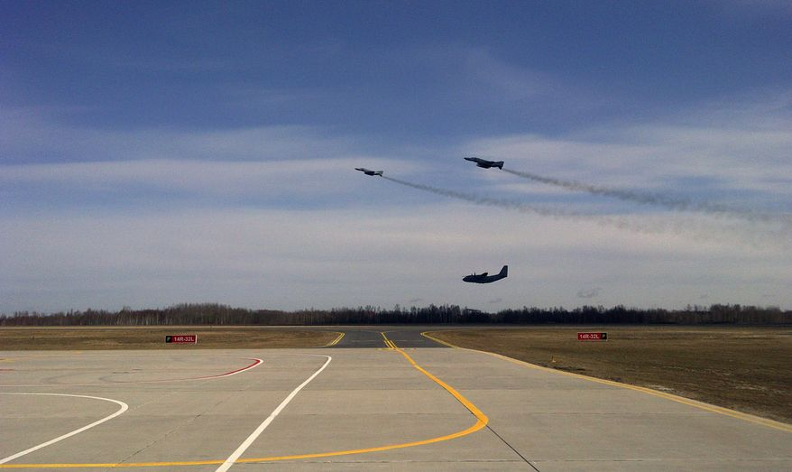 Two German F-4 fighter jets escort a Lithuanian C-27J Spartan transport plane (bottom) back to Siauliai Air Base  in Lithuania during a military exercise on Wednesday, March 28, 2012. (AP Photo/Don Melvin)