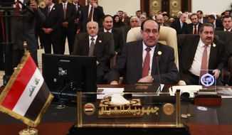 Iraqi Prime Minister Nouri al-Maliki (center) attends the Arab League summit in Baghdad on Thursday, March, 29, 2012. Only 10 leaders of the 22-member bloc are in attendance. (AP Photo/Karim Kadim)
