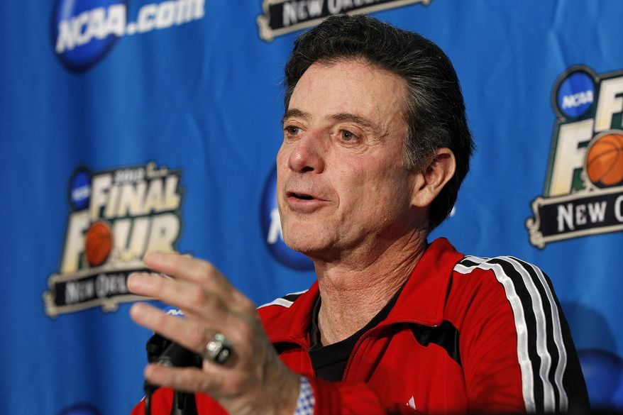 Louisville head coach Rick Pitino talks to reporters during a news conference in New Orleans on Thursday, March 29, 2012. Louisville will play Kentucky in an NCAA tournament Final Four game on Saturday. (AP Photo/Gerald Herbert)