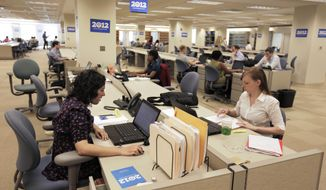**FILE** Staff members work at President Obama's 2012 re-election campaign headquarters during a media tour of the new facility in Chicago on  May 12, 2011.