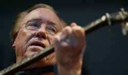 Earl Scruggs performs at the Bonnaroo Music & Arts Festival in Manchester, Tenn., in June 2005. (AP Photo/Eric Parsons, File)