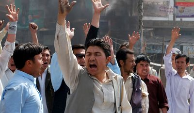 Protesters shout slogans against the Pakistani government to condemn killings in Quetta, Pakistan, on Thursday, March 29, 2012, after an attack by a gunman who appeared to target local employees of the U.N. Food and Agriculture Organization, officials said. (AP Photo/Arshad Butt)