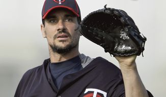 FILE - In this Feb. 21, 2012 file photo, Minnesota Twins pitcher Carl Pavano works out during baseball spring training in Fort Myers, Fla. A high school classmate of Minnesota Twins pitcher Carl Pavano threatened to reveal an alleged homosexual relationship they had and to write a book about it unless Pavano apologized to him and bought him a navy Range Rover SUV with tan leather, according to a search warrant affidavit filed by police in Connecticut. (AP Photo/David Goldman, File)