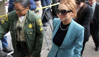 Lindsay Lohan arrives March 29, 2012, for a progress report on her probation for theft charges at Los Angeles Superior Court. (Associated Press)
