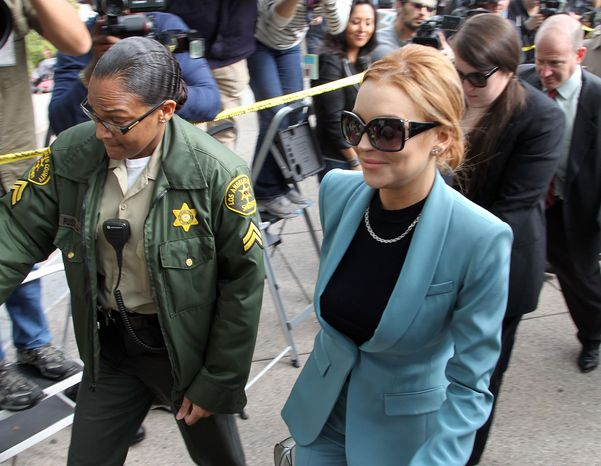 Lindsay Lohan arrives March 29, 2012, for a progress report on her probation for theft charges at Los Angeles Supe