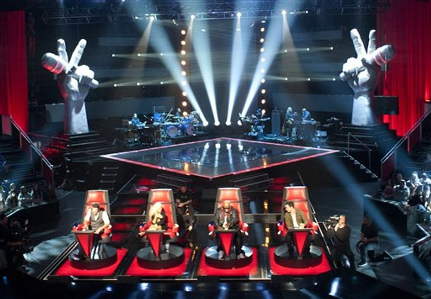 "In this undated image released by NBC, judges, seated from left, Blake Shelton, Christina Aguilera, Cee Lo Green and Adam Levine are shown during a rehearsal for the second season of ""The Voice,"" in Los Angeles. A new Facebook application will allow fans of NBC's ""The Voice"" to vote for their favorite artists through their Facebook profiles, now known as their timelines. (AP Photo/NBC, Lewis Jacobs)"