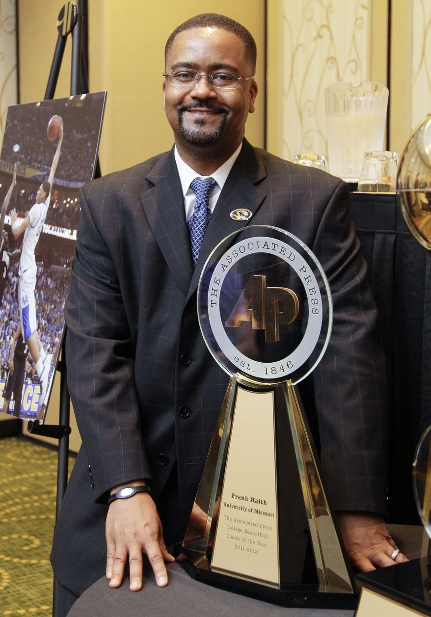 Missouri coach Frank Haith poses with his award as the Associated Press NCAA college basketball coach of the year on Friday, March 30, 2012, in New Orleans. (AP Photo/Mark Humphrey)