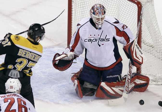 Washington Capitals goalie Tomas Vokoun left the game late in the first period with a groin injury. He was replaced by Michal Neuvirth, who made 19 saves in the 3-2 shootout win over the Bruins. (AP Photo/Elise Amendola)