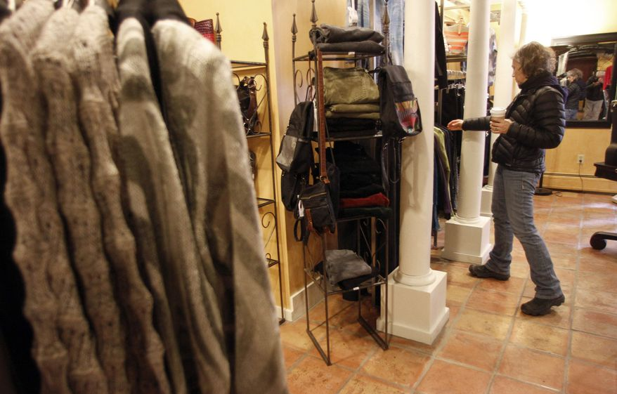 **FILE** Laurie Hanson looks over clothing Feb. 28, 2012, at the Adorn clothing store in Montpelier, Vt. (Associated Press)