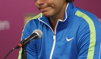 Rafael Nadal withdrew from his semifinal match against Andy Murray due to a knee injury, at the Sony Ericsson tennis tournament, Friday, March 30, 2012, in Key Biscayne, Fla. (AP Photo/Lynne Sladky)