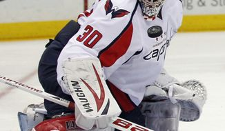 Washington Capitals goalie Michal Neuvirth went 13-13-5 with a 2.82 goals-against average and .903 save percentage last season. (AP Photo/Paul J. Bereswill)