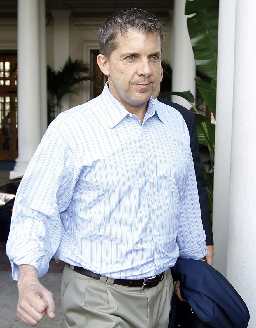 FILE - In this March 27, 2012 file photo, New Orleans Saints coach Sean Payton leaves the NFL owners meeting in Palm Beach, Fla. A person familiar with the decision says that Saints coach Sean Payton will file an appeal of his season-long suspension with the NFL on Friday, March 30, 2012. (AP Photo/Luis M. Alvarez, File)