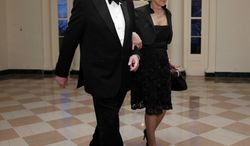 ** FILE ** In this March 14, 2012, file photo, Warren Buffett and Astrid M. Buffett arrive at the Booksellers area of the White House in Washington for the State Dinner hosted by President Barack Obama and first lady Michelle Obama for British Prime Minister David Cameron and his wife Samantha. (AP Photo/Charles Dharapak, File)