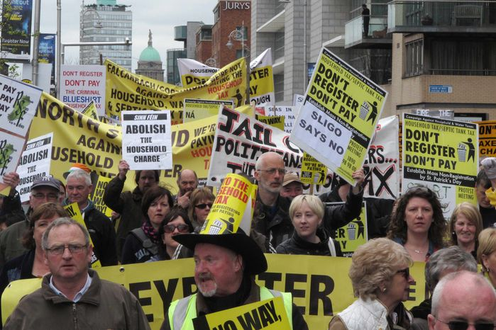 Some thousands of demonstrators march through the streets of Dublin, Ireland, Saturday March 31, 2012, during protests against Ireland's new property tax. Ireland faces a public revolt as more than 1 million of Ireland's 1.6 million households have failed to pay the new property tax. (AP Photo/Shawn Pogatchnik)