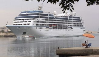 **  FILE ** The Maltese registered cruise ship, Azamara Quest, sails through the Suez canal, Egypt, in this April 30, 2010, file photo from the Red sea toward the Mediterranean sea on its way to Athens. The fire on the Azamara Quest started late Friday, March 30, 2012, a day after the ship left Manila for Sandakan, Malaysia, and was immediately put out, said coast guard spokesman Lt. Cmdr. Algier Ricafrente. (AP Photo/File)