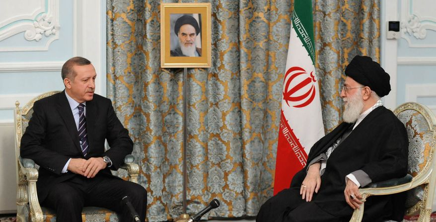 In this picture released by an official website of the Iranian supreme leader's office, Iranian supreme leader Ayatollah Ali Khamenei, right, meets with Turkish Prime Minister Recep Tayyip Erdogan, in the northwestern city of Mashhad, Iran, Thursday, March 29, 2012. (AP Photo/Office of the Iranian Supreme Leader)