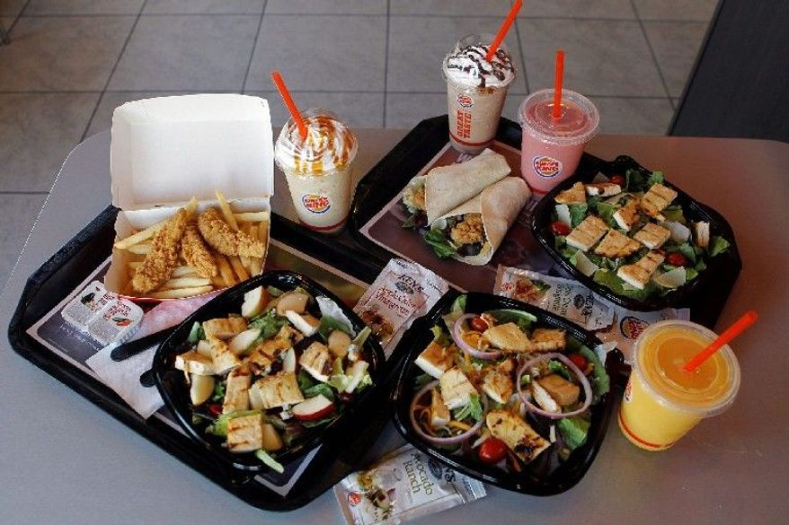 In this March 28, 2012 photo, new food items sit on display at a Burger King restaurant in Miami. Burger King launches 10 menu items including smoothies, frappes, specialty salads and snack wraps in a star-studded TV ad campaign. It's the biggest menu expansion since the chain opened its doors in 1954. (AP Photo/Luis M. Alvarez)