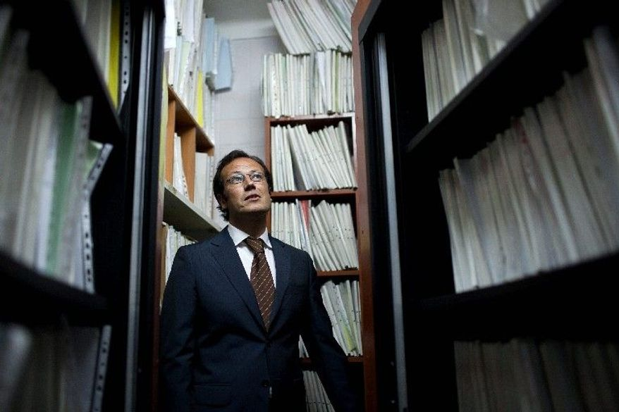 (nothing)  WITH STORY SLUGGED PORTUGAL HARD TIMES - Luis Sequeira Fernandes, a solicitor who runs one of Portugal's biggest bailiff offices, stands among thousands of processes files in one of the storage rooms of his firm in Alcochete, outside Lisbon, March 12 2012. Fernandes says that when his staff, acting on court orders, pursue assets to convert to cash they are increasingly finding that debtors have nothing left to confiscate. Lenders demanded debt-reducing austerity measures have helped pitch the country into a steep decline, with a second straight year of worsening recession, and record unemployment, prompting the plight of personal bankruptcy for many Portuguese families. (AP Photo/Armando Franca)