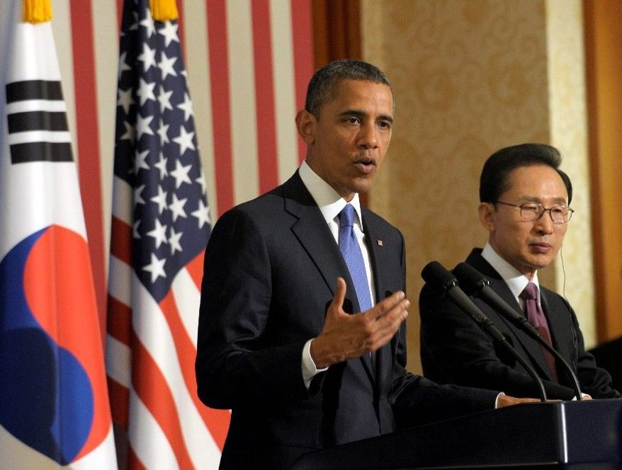 President Obama talks of reunification with North Korea during his visit to South Korea. President Lee Myung-bak is on hand. (Associated Press)