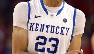 Kentucky forward Anthony Davis had 18 points and 14 rebounds in a 69-61 semifinal win over Louisville on Saturday. (Associated Press)
