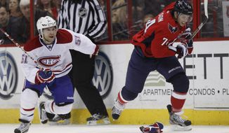 Montreal Canadiens center David Desharnais, left, and Washington Capitals defenseman John Carlson race up the ice during the third period of an NHL hockey game on Saturday, March 31, 2012 in Washington. (AP Photo/Evan Vucci)